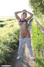 Busty Fitness Girl Stasia Gets Nude On A Field 02