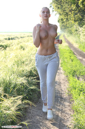 Busty Fitness Girl Stasia Gets Nude On A Field 04