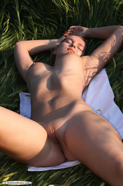 Busty Fitness Girl Stasia Gets Nude On A Field 16
