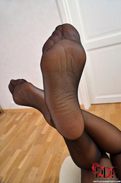 Sexy feet in black stockings 12