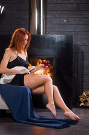 Sexy Ukrainian redhead Michelle H looks hot in every sense of the word 01