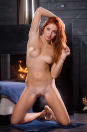 Sexy Ukrainian redhead Michelle H looks hot in every sense of the word 13