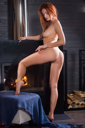 Sexy Ukrainian redhead Michelle H looks hot in every sense of the word 18