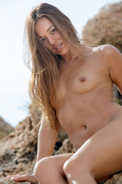 Hot Brunette Dominika Naked On The Rocks 08