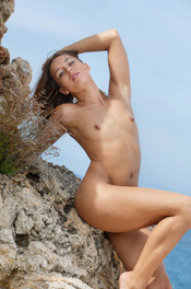 Hot Brunette Dominika Naked On The Rocks 12