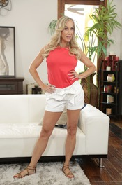 Busty Blonde MILF Brandi Love Undressing On The Sofa 00