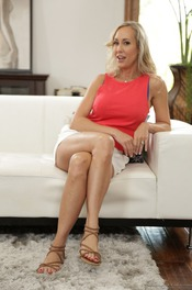Busty Blonde MILF Brandi Love Undressing On The Sofa 01
