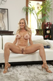Busty Blonde MILF Brandi Love Undressing On The Sofa 12