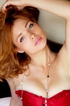 Redhead Girl In Corset
