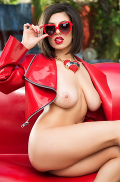 Darcie Dolce Poses Outside In Heart Sunglasses And Heels