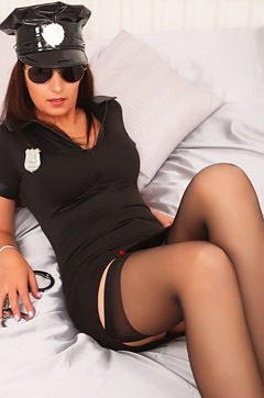 Sexy Cop Rebecca Strips On A Bed